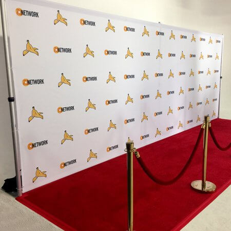 A long, colorful step and repeat