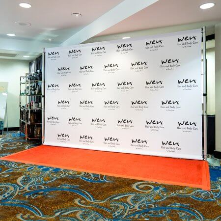 An 8 by 12 foot fabric step and repeat for WEN by Chaz Dean