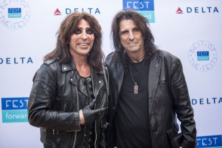 Alice Cooper posing in front of a step and repeat at Fest Forward.