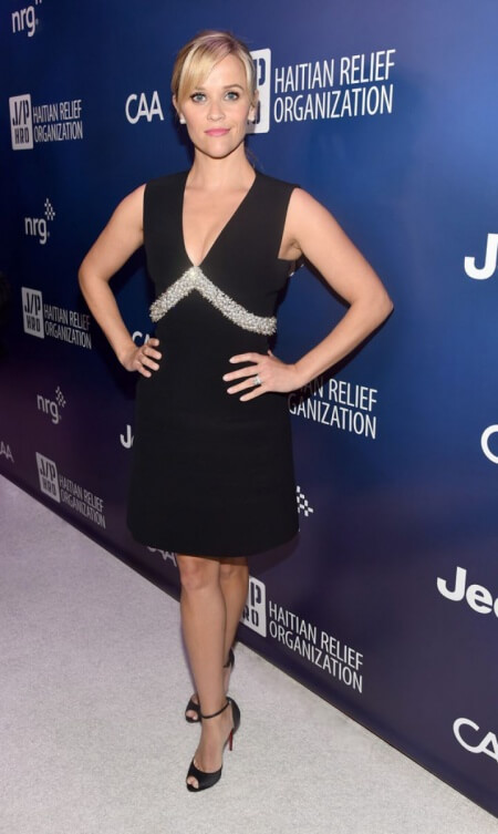 Reese Witherspoon poses in front of our backdrop at the Habitat Relief Organization