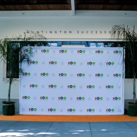 8' x 12' Step and repeat backdrop for the Huntington library with our pipe and base stand and white pole covers.