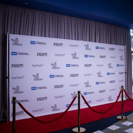 8' x 16' backdrop, pipe and base stand, stanchions, rope and red carpet for The Writers Guild Foundation.