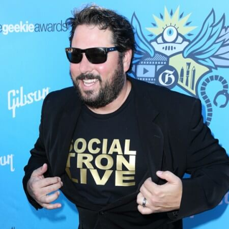 Greg Grunberg in front of a step and repeat at the Geekie Awards