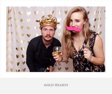 A simple photo backdrop with gold hearts