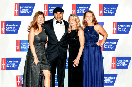 American Cancer Society group and LL Cool J in front of step and repeat for a wonderful charity event.
