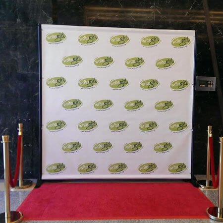 A custom 8 by 8 foot step and repeat for WriteGirl