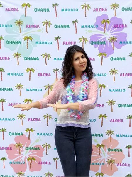 A Hawaiian style backdrop and leis for your customer photos!