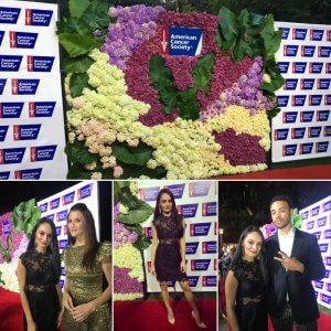 We printed two 8'x 5' step and repeat backdrops to go on either side of this beautiful floral wall.