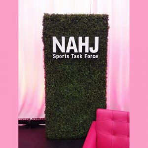 Hedge wall and custom cut-out letters for NAHJ Sports Task Force.