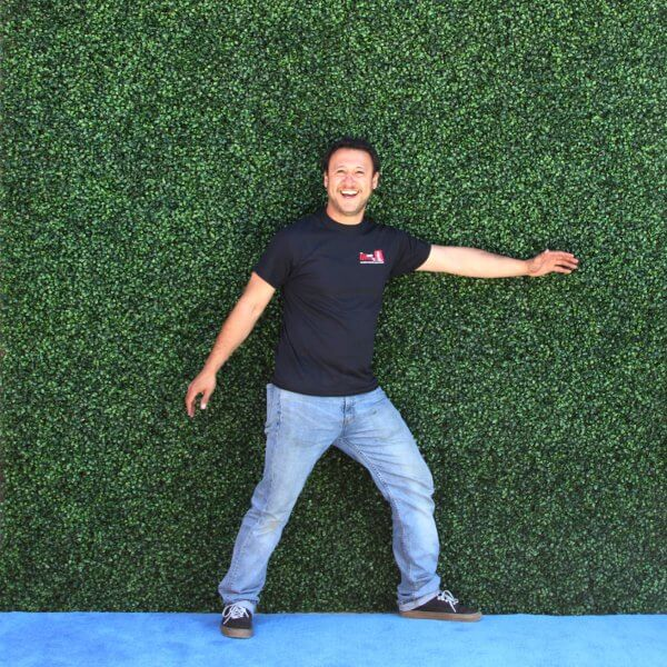 Man in front of a Hedge Roll backdrop