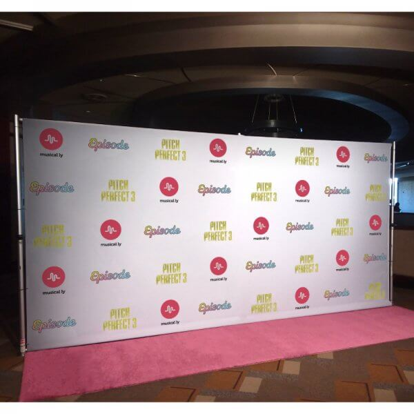 An 8 by 16 foot fabric step and repeat backdrop