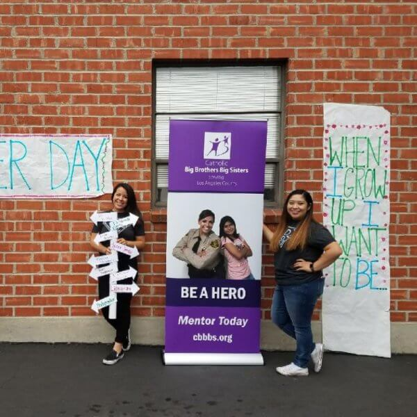 A Merlin retractable banner for Catholic Big Brothers Big Sisters