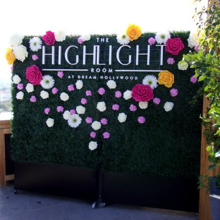 8 by 8 foot Hedge Wall with custom cutout lettering and flowers