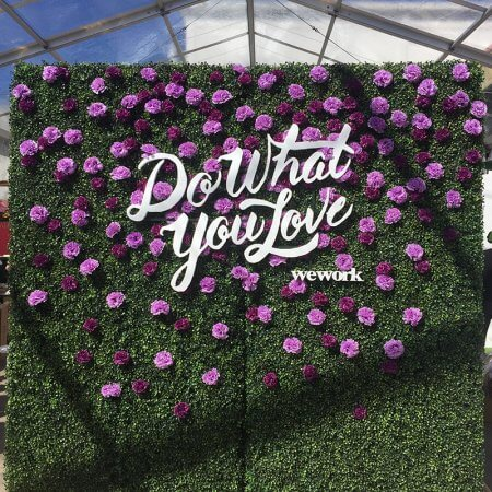 A Hedge Wall with custom cutout lettering and flowers
