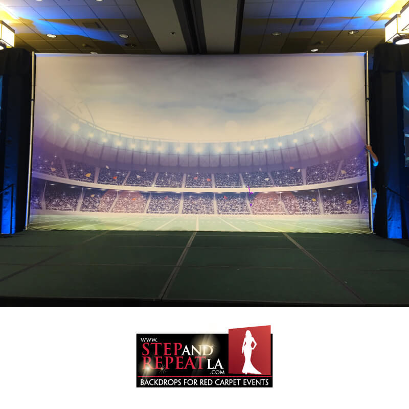 Custom 8' x 12' football stadium backdrop.