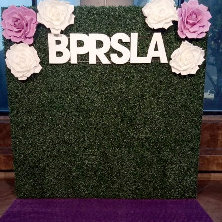 Two 4' x 8' hedge flats decorated with our beautiful foam flowers and custom lettering we fabricated.