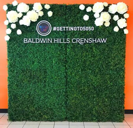 Beautiful hedge wall with flowers for Baldwin Hills Crenshaw promo.