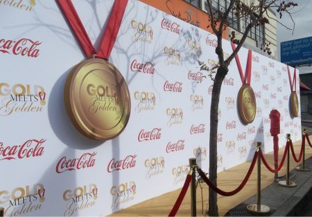 We fabricated these custom gold 3-D metals with red ribbon for the Gold meets Golden event.
